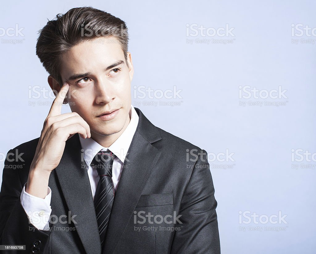 Young businessman thinking of idea royalty-free stock photo