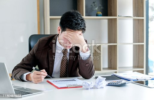 istock Young businessman tired and stressed from work. 1130461653