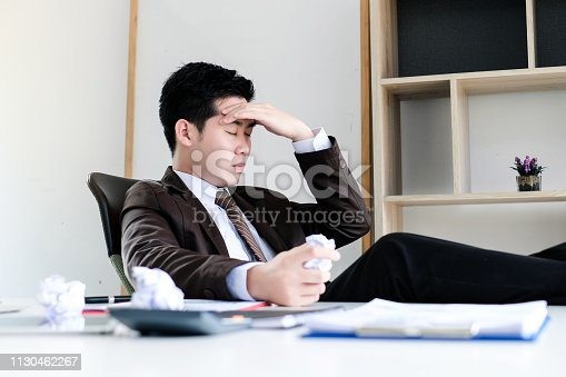833210686 istock photo Young businessman tired and stressed from work. 1130462267