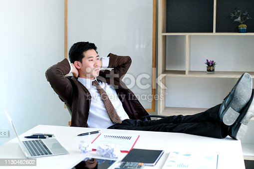 istock Young businessman tired and stressed from work. 1130462602