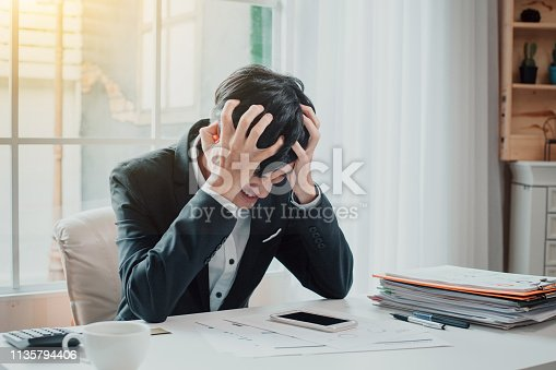 istock Young businessman tired and stressed from work. 1135794406