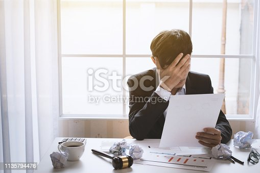 istock Young businessman tired and stressed from work. 1135794476