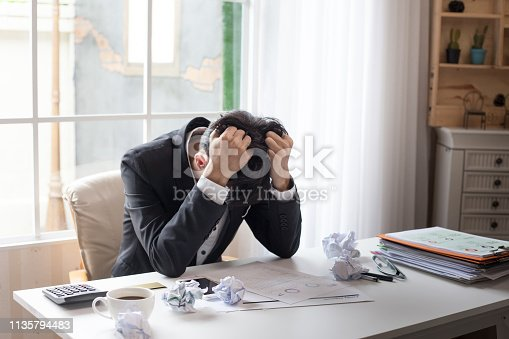 istock Young businessman tired and stressed from work. 1135794483