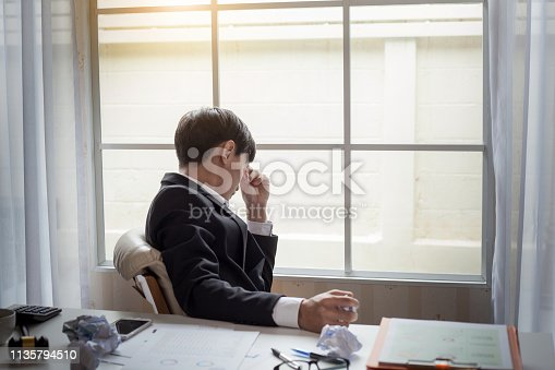 istock Young businessman tired and stressed from work. 1135794510