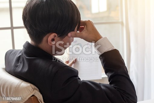 istock Young businessman tired and stressed from work. 1135794537