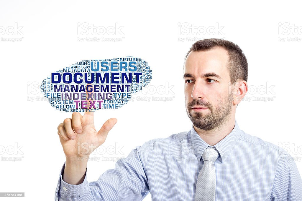 Young businessman touching 'Document Management' word cloud stock photo