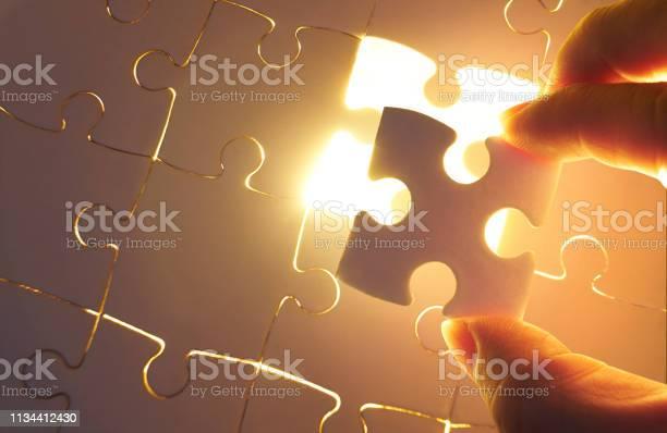 Young businessman trying to put back missing jigsaw puzzle piece picture id1134412430?b=1&k=6&m=1134412430&s=612x612&h=as11z7qosjeaigskumacw02amgabbelwyu3sz10i02w=