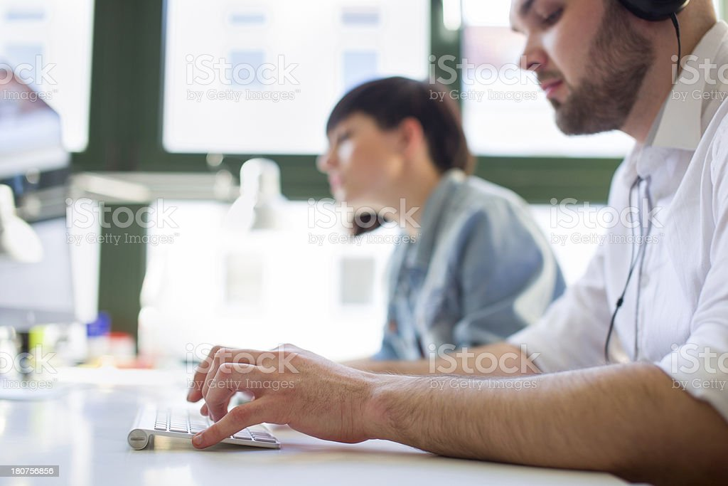 Young Businessman typing on keyboard stock photo