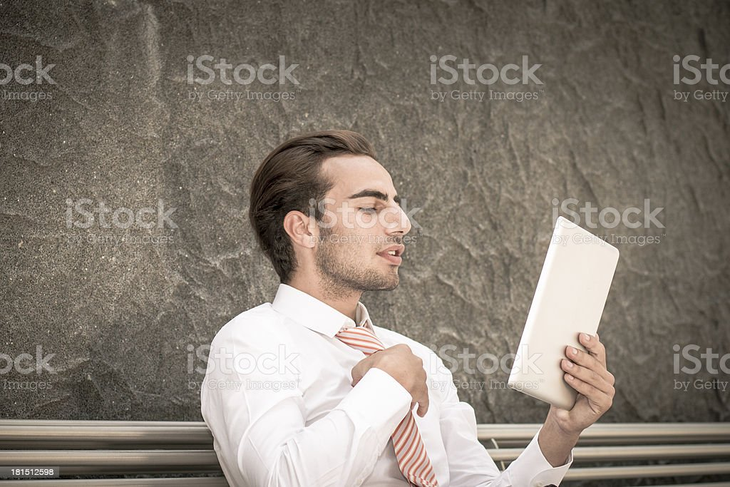 Young businessman use tablet like mirror royalty-free stock photo