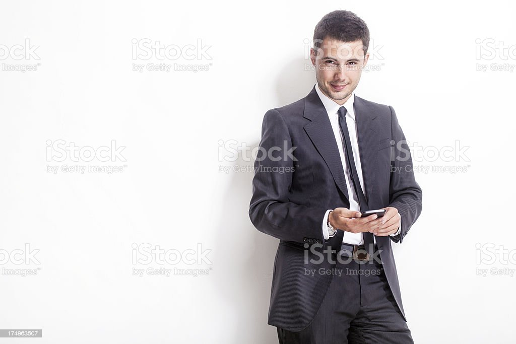 Young businessman using a smartphone royalty-free stock photo
