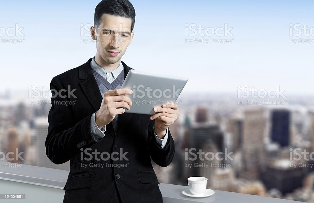 Young Businessman Using A Tablet Computer royalty-free stock photo