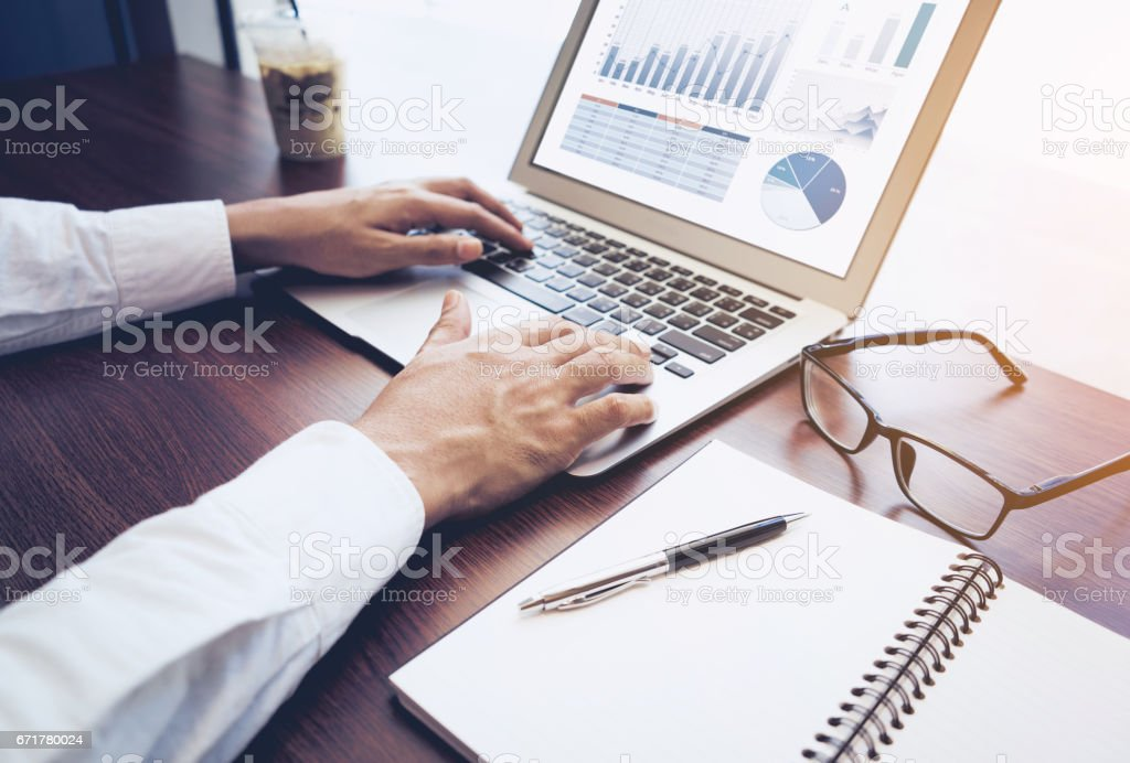 Young businessman using computer laptop stock photo