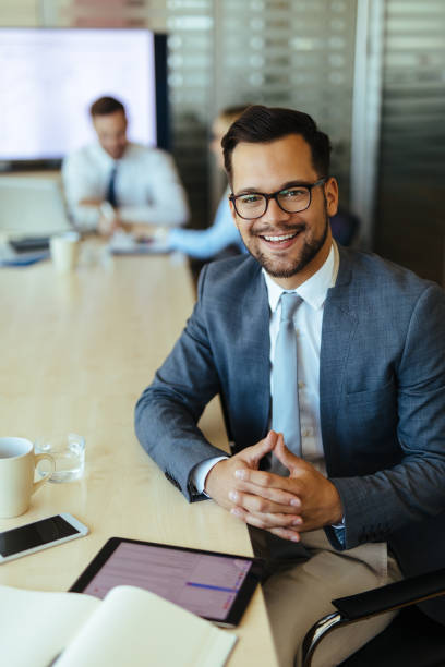 Young businessman using digital tablet and analyzing business report stock photo