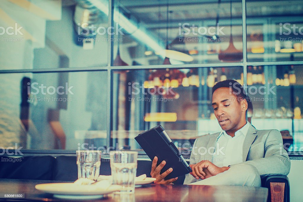 Young businessman using digital tablet stock photo