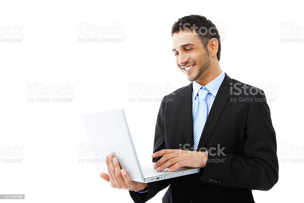 Young businessman using laptop stock photo