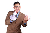 istock Young Businessman Using Megaphone, Promoting Gesture 1073541626