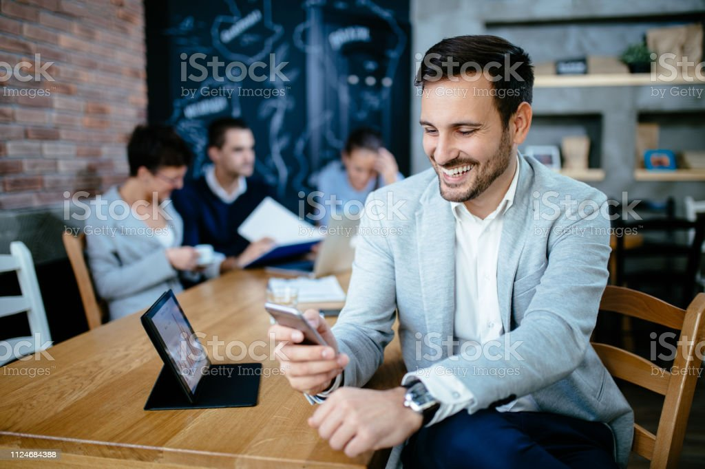 Young businessman using mobile in the office stock photo