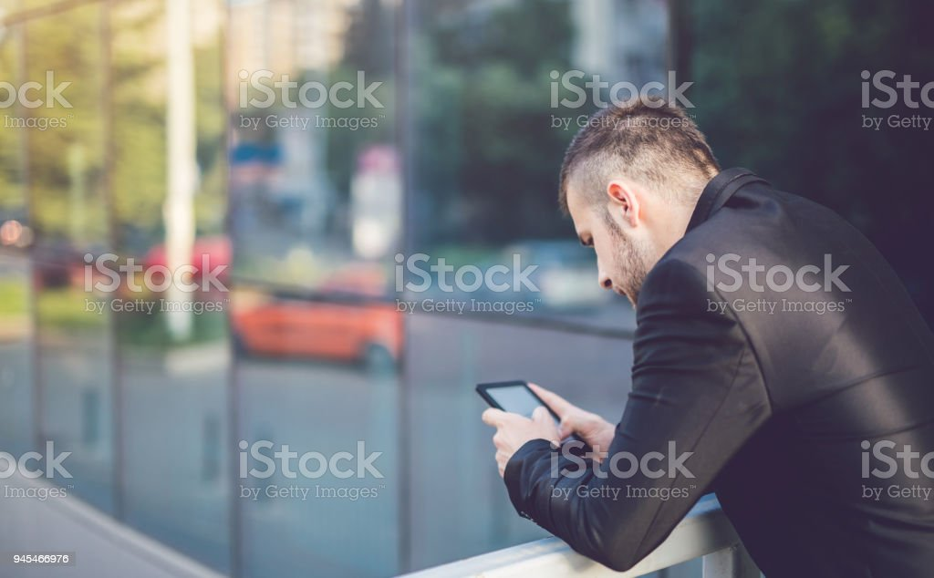 Young businessman using tablet outdoor. stock photo