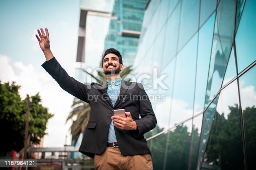 Young businessman waiving to his friend