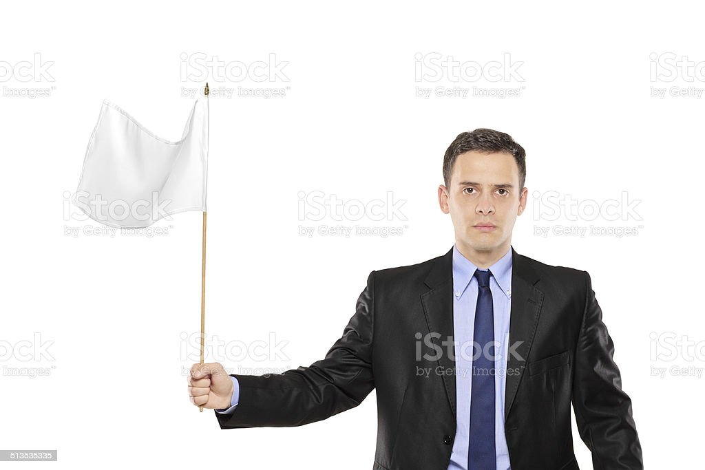 Young businessman waving a white flag stock photo