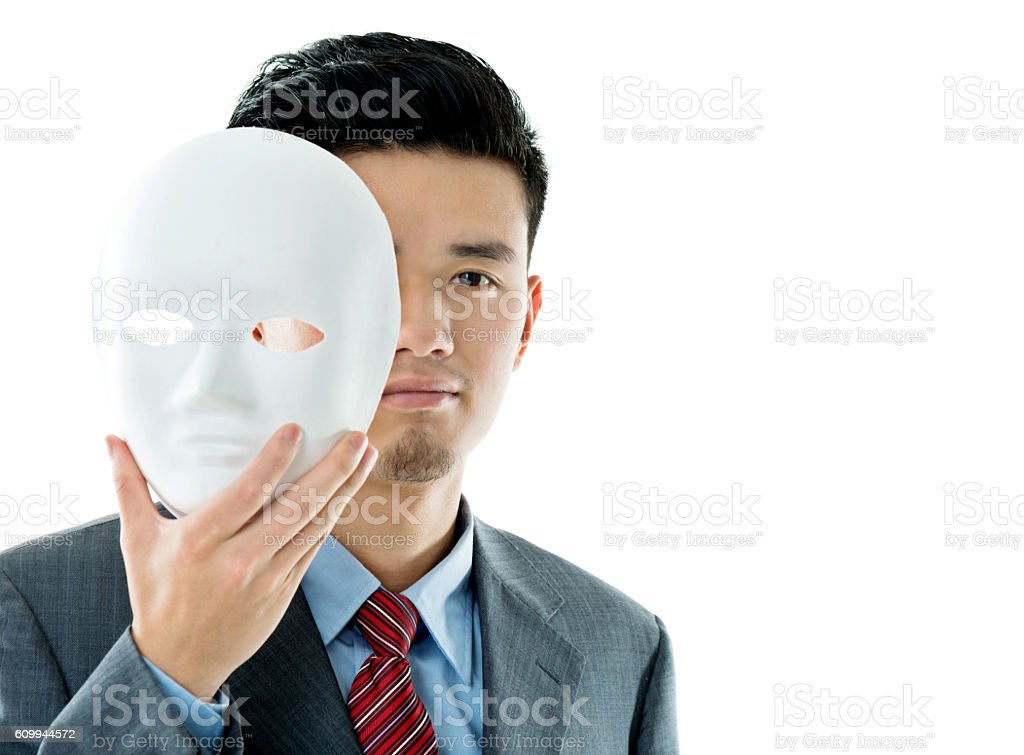 Young businessman wearing a face mask against white background stock photo