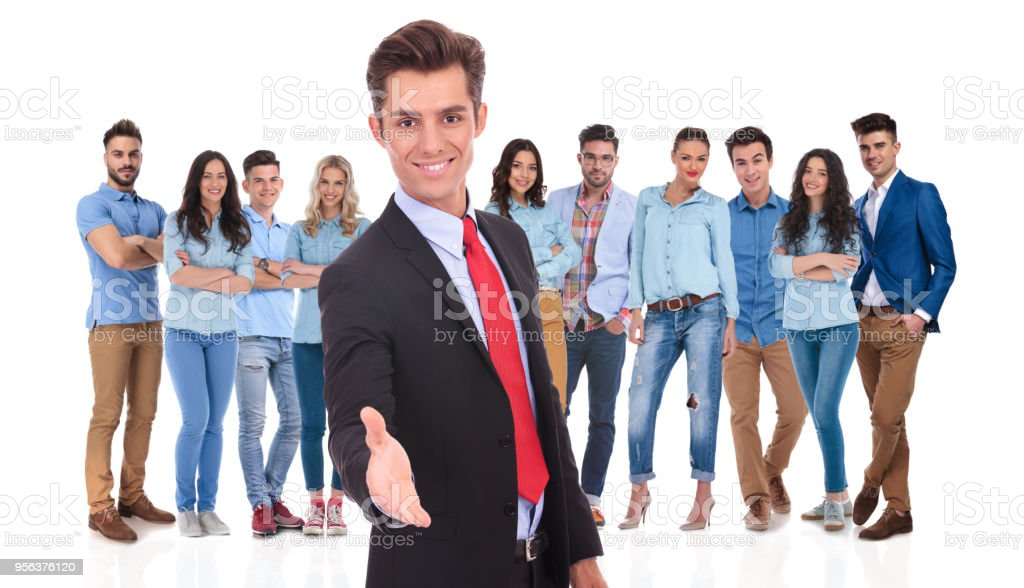young businessman welcomes you to his team with a handshake stock photo
