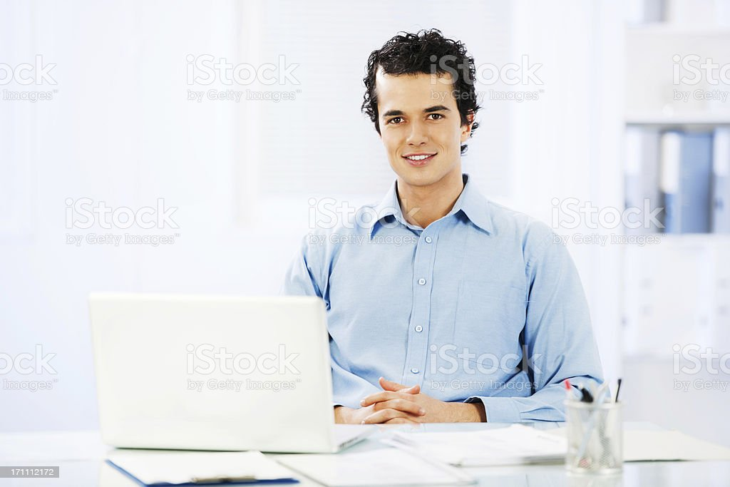 Young businessman with a laptop royalty-free stock photo