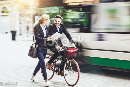 istock Young businessman with bike on the street 497310688
