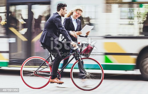 istock Young businessman with bike on the street 497391350