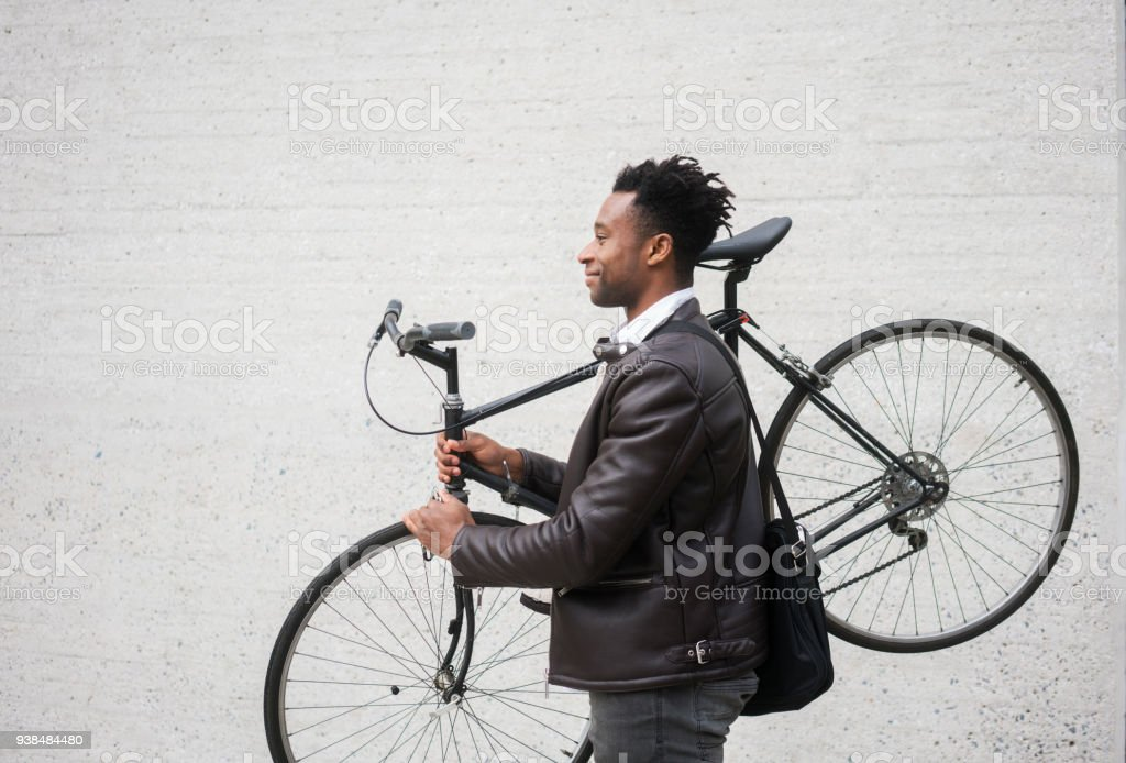 Young businessman with bike stock photo