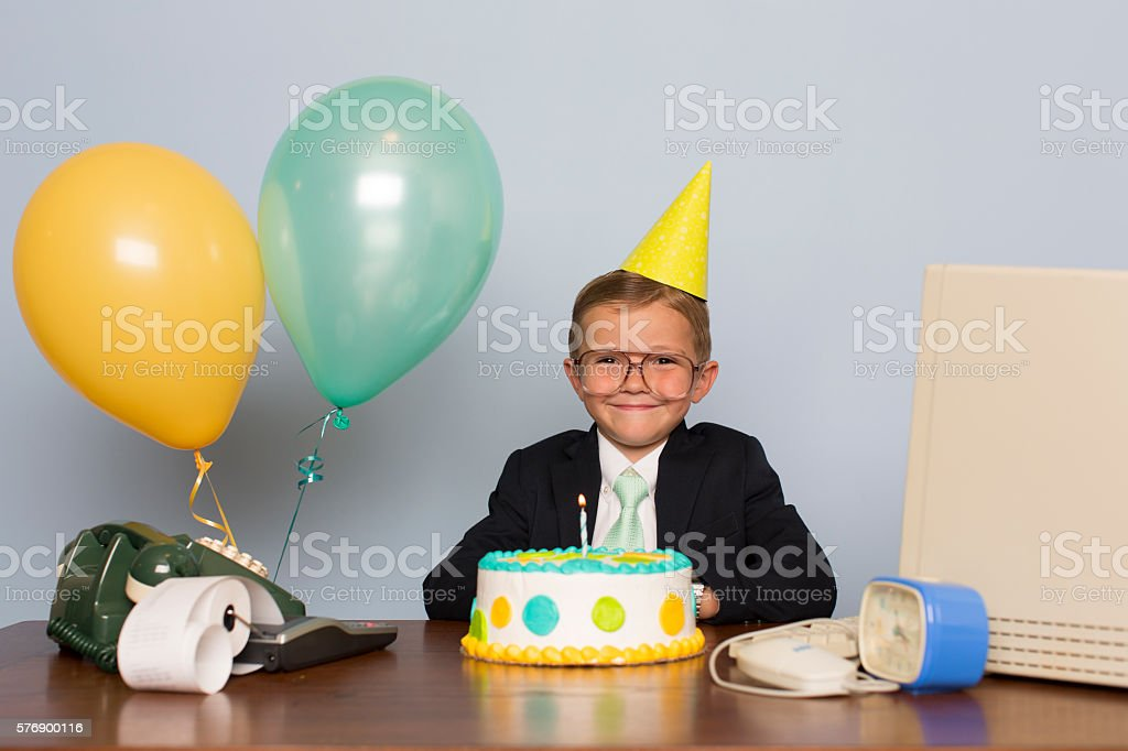 Young Businessman with Birthday Cake at Office Birthday Party stock photo