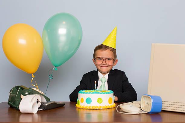 young businessman with birthday cake at office birthday party - super torte stock-fotos und bilder