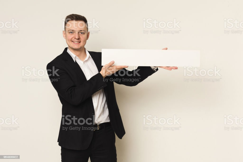 Young businessman with blank white paper royalty-free stock photo