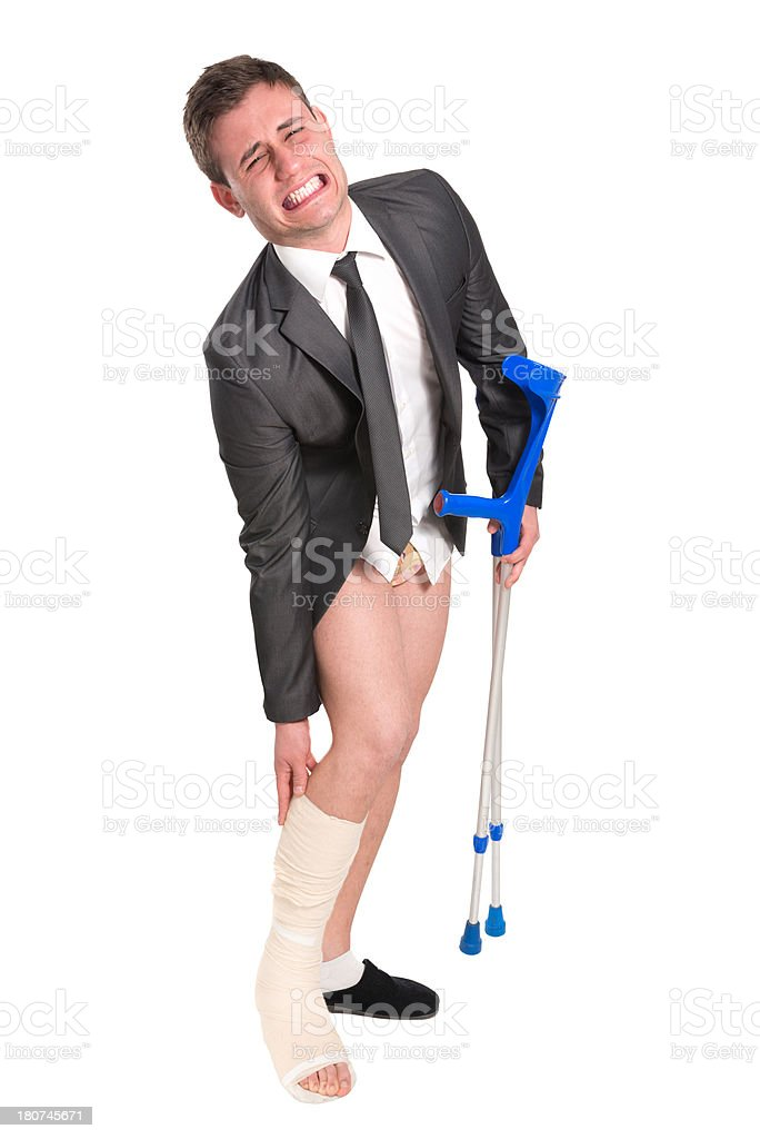 Young Businessman with Broken Leg Screaming of Pain royalty-free stock photo