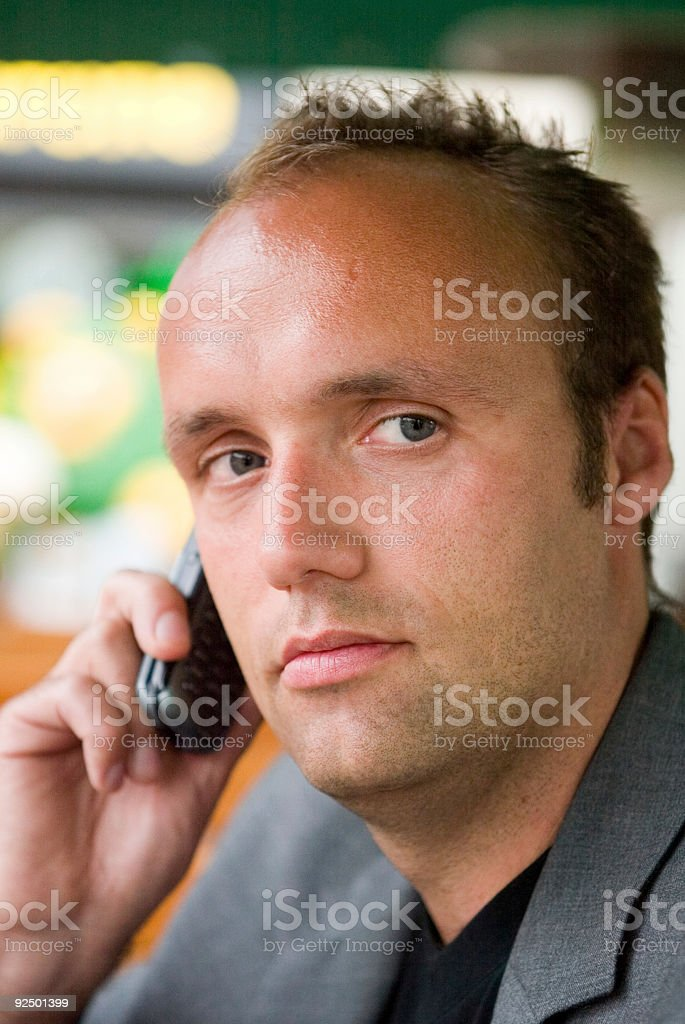 young businessman with cell phone royalty-free stock photo