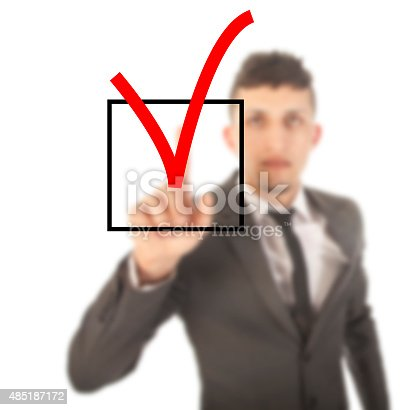 istock Young businessman with checkbox isolated on white background 485187172
