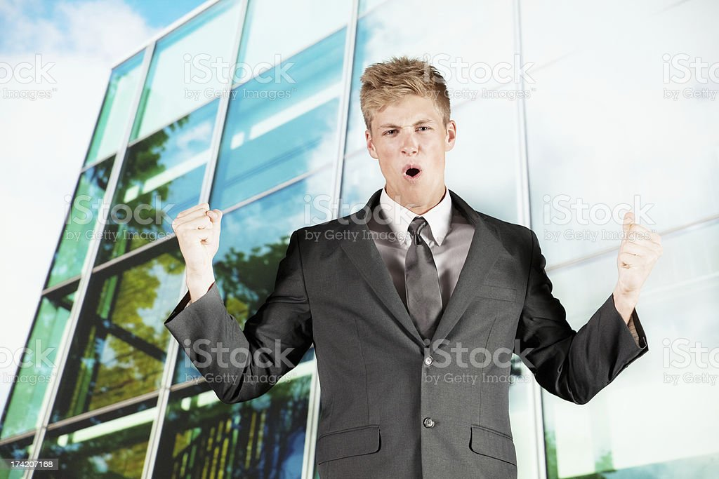 Young businessman with clenched fist royalty-free stock photo