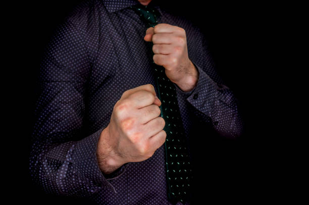 Young businessman with fists stock photo