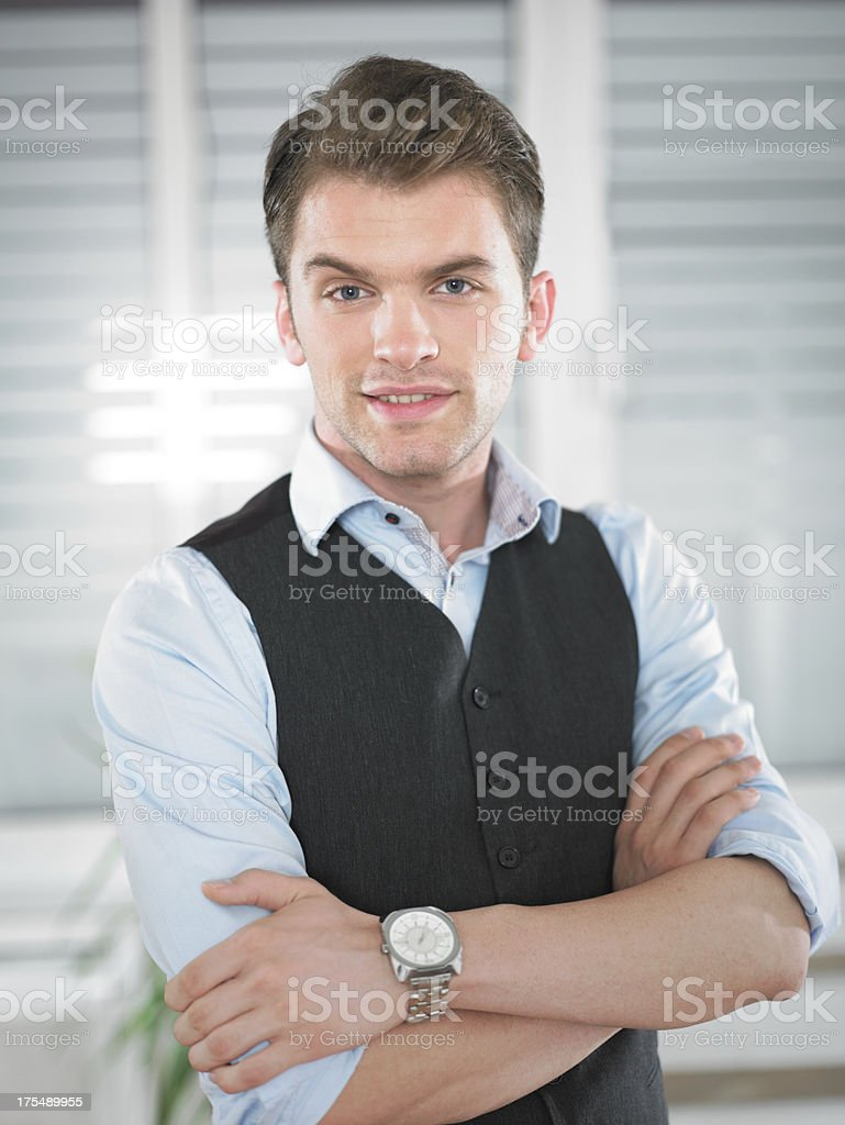 young businessman with folded arms stock photo