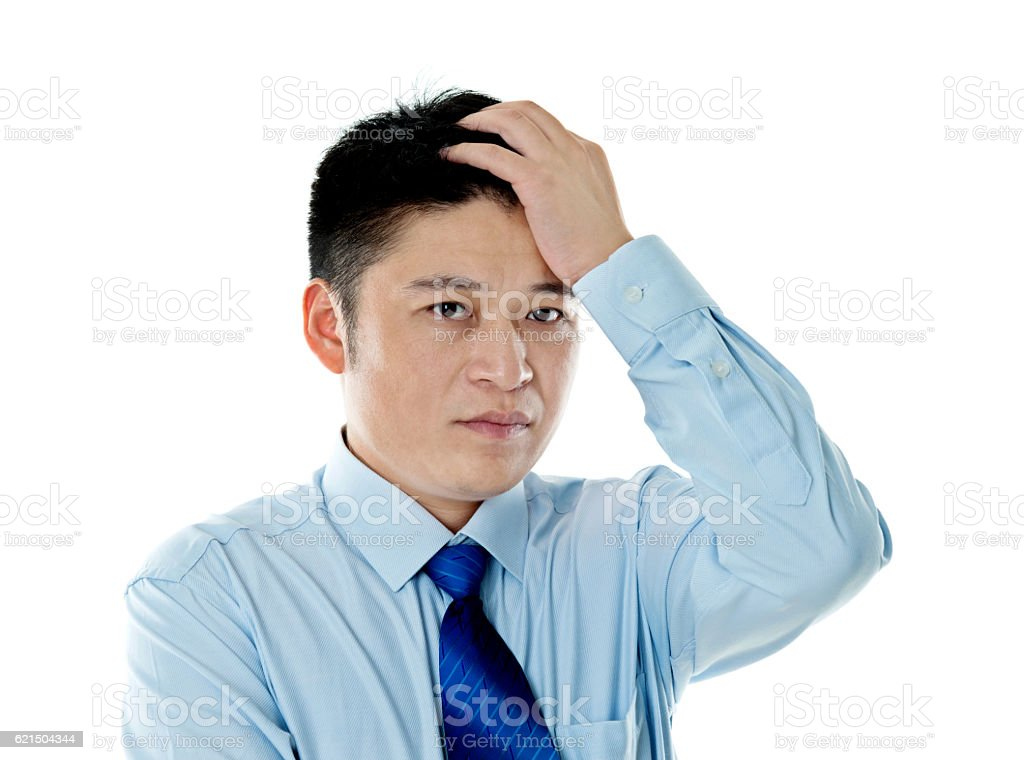 Jeune homme d'affaires avec un Mal de tête photo libre de droits