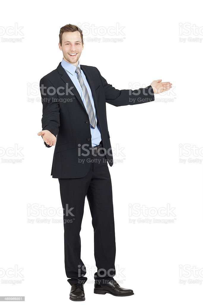 A young businessman with his arms outstretched stock photo