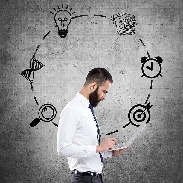 young businessman with infographic icons - zandloper icoon stockfoto's en -beelden