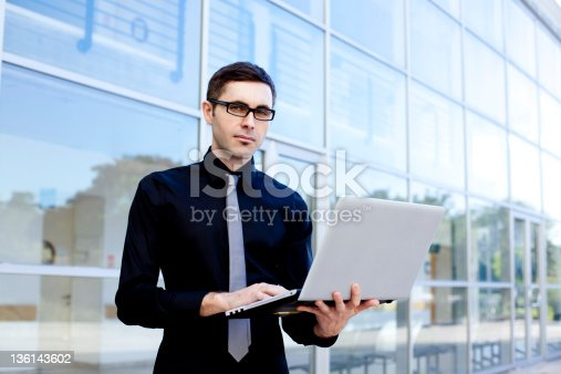 1024730528 istock photo Young businessman with laptop 136143602