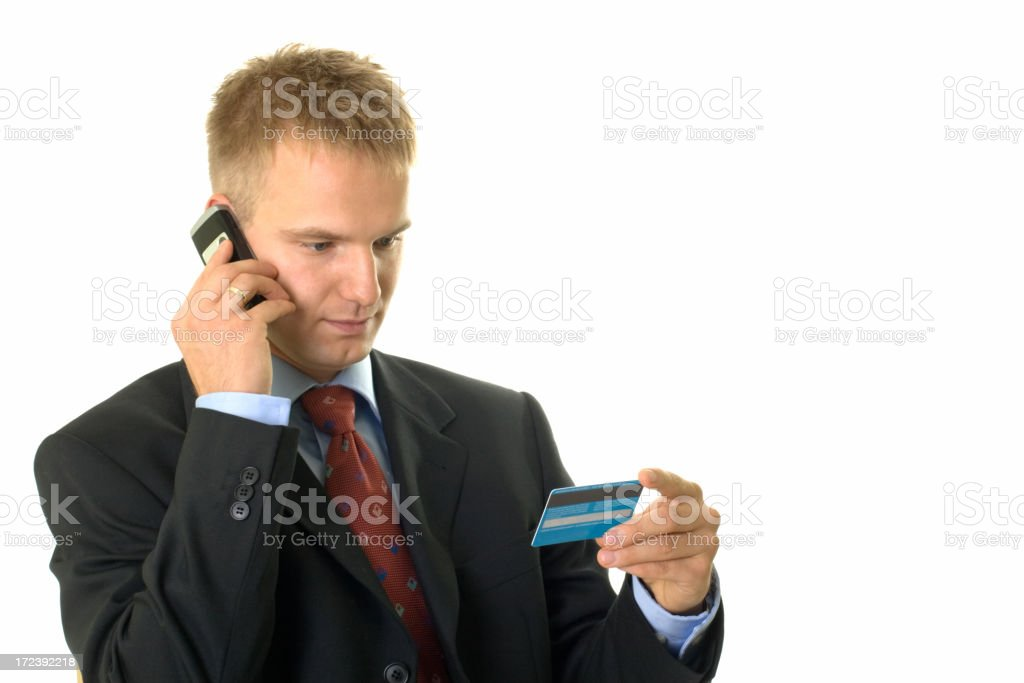 young businessman with mobile phone and credit card royalty-free stock photo