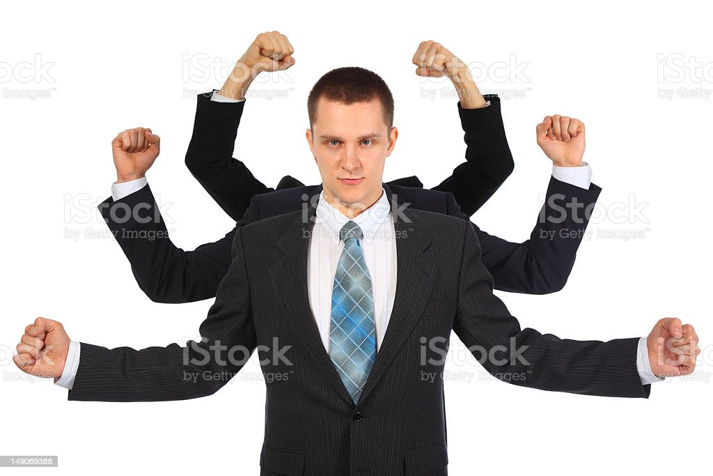 Young businessman with six fists stock photo