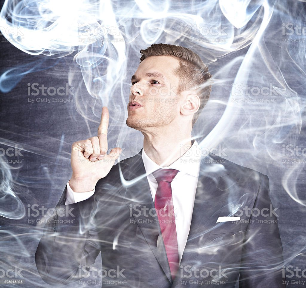 Young businessman with smoking finger stock photo