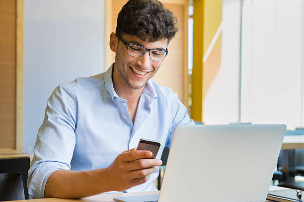 Young businessman working at café stock photo
