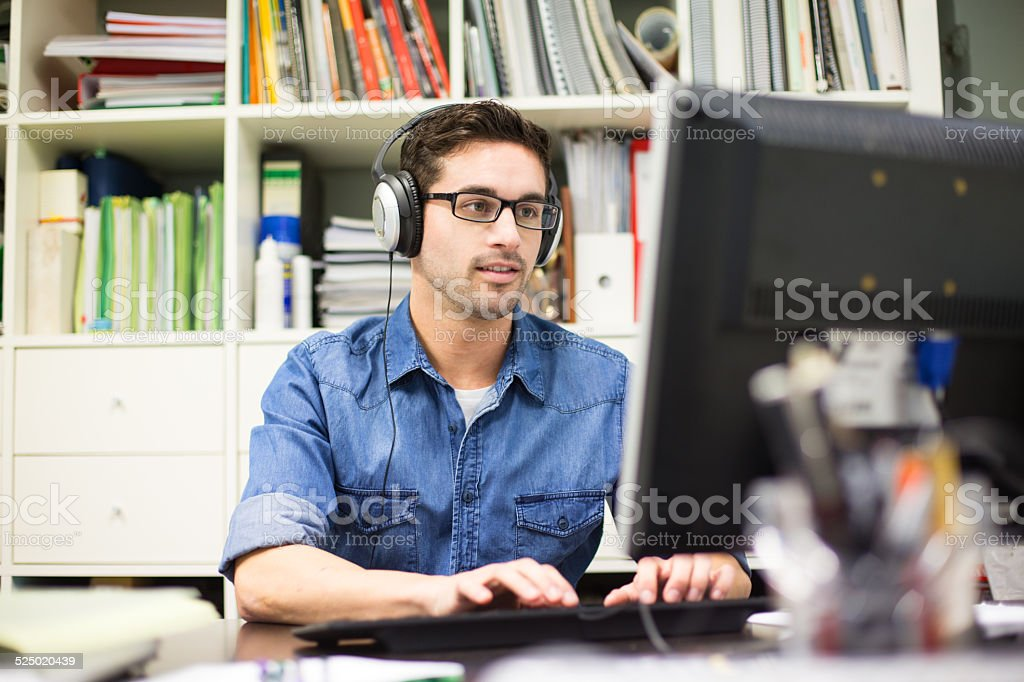 Young businessman working at start up stock photo