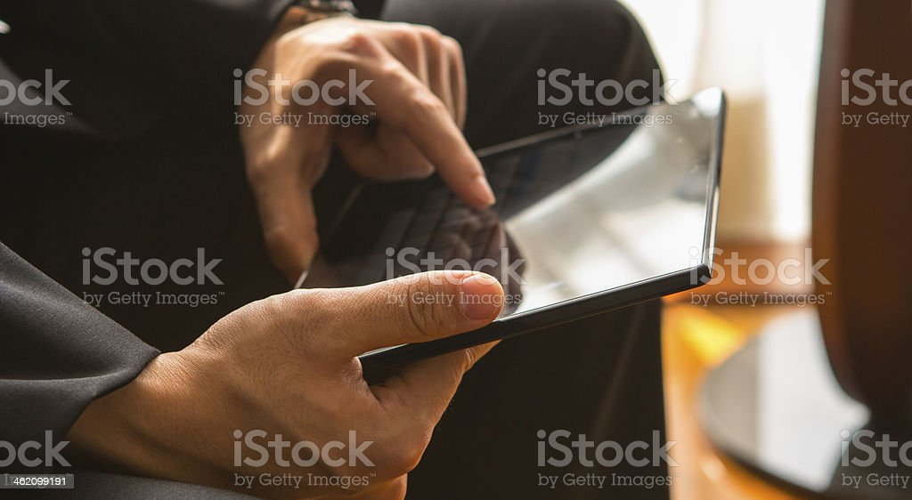 Young businessman working by using tablet. stock photo