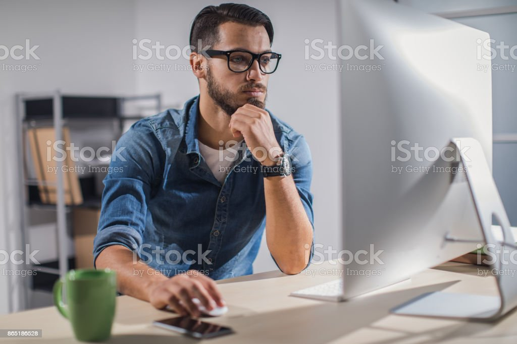 Young businessman working late in the office stock photo